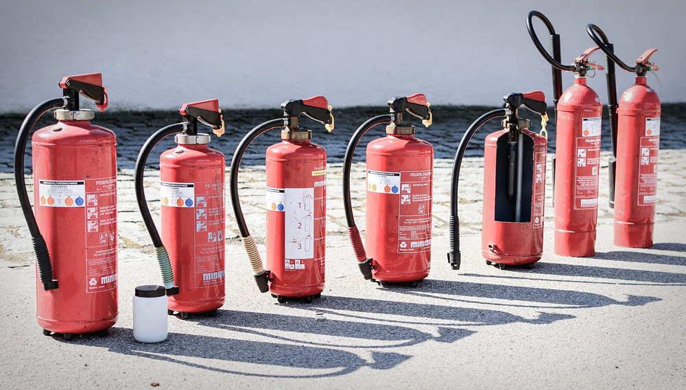 Various Fire Extinguishers - History of the home and business fire extinguisher